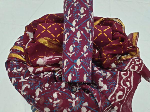 Burgundy color rapid print cotton suit with zari border