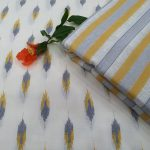 White and Yellow running cotton dress materiel for ladies