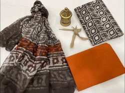 Taupe gray and Deep Carrot Orange cotton printed dress material with chiffon dupatta