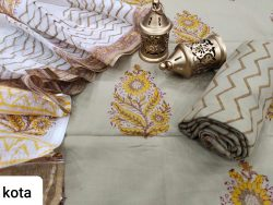 Tan and white salwar kameez suit with kota doria dupatta