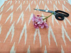 Medium Apricot ikkat running fabric for indian ethnic wear suit