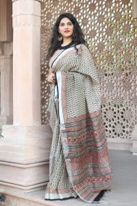 Carmine and beige cotton linen saree with printed cotton blouse