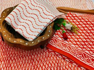 Orange-red and white cotton salwar suits with chiffon dupatta